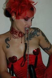 tattooed brunette red corset