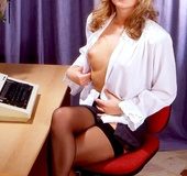 Steaming hot blonde secretary takes off her white blouse and reveals her