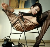 Foxy chick with stunning body wearing black shirt, stockings and high