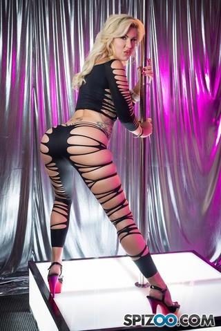 blonde bombshell dances pole