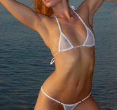 Foxy blonde teases with her steaming hot body wearing her white bikini