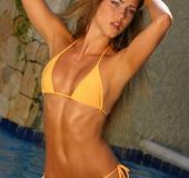 Foxy babe displays her banging body wearing her orange bikini in different