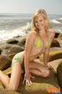 Blonde bombshell wearing green and yellow bikini teases with her smoking