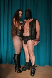 dominatrix punishes her leather