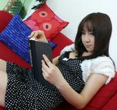 Delightful brunette wearing black polka dotted dress and white vest getting