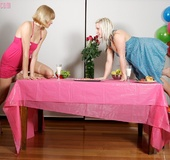 Luscious blondes strip off their pink and blue dresses and expose their
