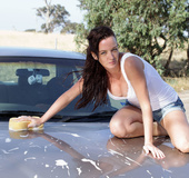 Baning babe displays her smoking hot body while she washes a car before