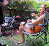 Pink haired chick peels off her orange dress and displays her smoking