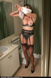 nylons-wearing brunette sitting toilet