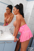 Pink get-up ponytailed brunette masturbating in a bathtub