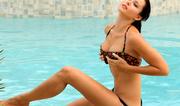 colorful bikini brunette gets