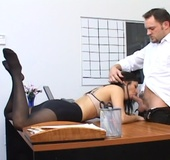 Dark haired brunette in black stockings sheds black suit and gets twat