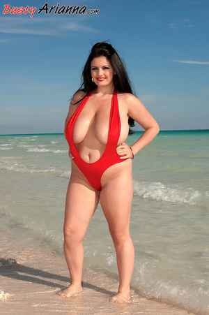 Red one-piece swimsuit brunette goes ski - XXX Dessert - Picture 1