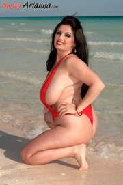 red one-piece swimsuit brunette