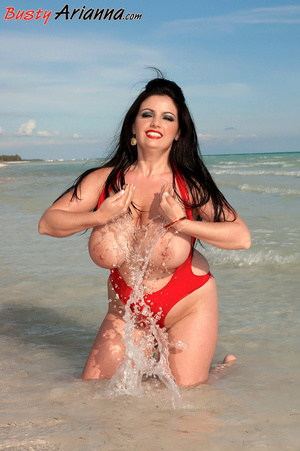 Red one-piece swimsuit brunette goes ski - XXX Dessert - Picture 7