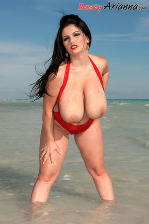 Red one-piece swimsuit brunette goes ski - XXX Dessert - Picture 10