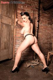 corset-wearing brunette dominatrix gets