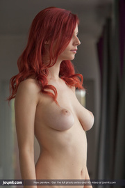 alluring redhead lays down