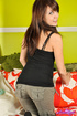 Black tank top and a sexy scarf brunette get naked on a bed
