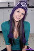 BEautiful brunette with amazing eyes wearing her purple hat takes off