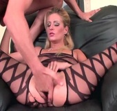 Blonde in crotchless bodystockings gets her pierced cunt fingered and