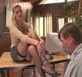 Blonde beauty in fishnet stockings sheds grey miniskirt gets cum on her