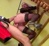 Busty blonde in seethrough top and black stockings stroking hard pecker