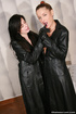 A pair of young babes in leather coats and high boots licking and fingering