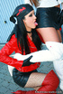 Black haired chick in fishnet stockings and red leather jacket teasing