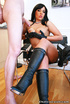 Black haired gal with red lips and big breast took off leather jacket