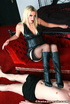 Red lipped blonde in leather outfit and black panty riding naked guy's