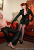 Mature redhead in glasses and leather outfit gets her ass cum covered