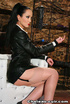 Red lipped mistress in opaque stockings and leather outfit blowing two
