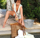 Lace panties brunette with curly hair washes clothes in the pool and spanks