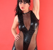 Dominatrix-y outfit brunette with bangs barely hiding her pussy