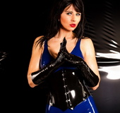 MILF-y brunette in blue latex get-up goes all femme fatale