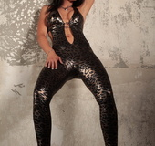 Leopard-y latex bodysuit brunette shows off her amazing ass next to a