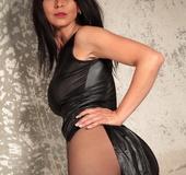 Fancy latex dress brunette shows off her black pantyhose