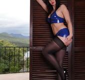 High heels and black stockings brunette posing on camera