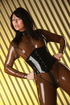 Brown latex and black high heels brunette shows her pierced pussy up close