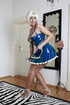 Blonde wig maid dressed in latex flashes her pantyhose-covered ass