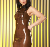 Tight latex brunette shows off her barely covered nipples