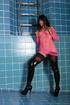 Leggy brunette in a pink fishnet top posing in an empty pool