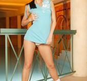 Short blue dress and white socks brunette undressing poolside