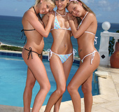 Three bikini-clad teens 69-ing fingering and licking each other