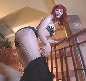 Redhead babe sheds black skirt and tight undies before ripping her pantyhose