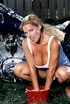 Wet white top blonde shows her glistering body outdoors