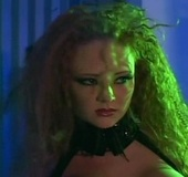 Curly hair redhead in black latex lingerie and gloves gets her tight ass