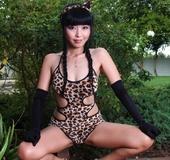 Cheetah get-up Asian brunette posing naked outdoors