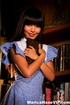 Blue get-up Asian brunette reading books and getting naked